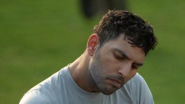 Yuvraj Singh checks his helmet during a training session