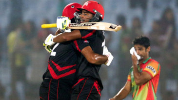 Haseeb Amjad and Nadeem Ahmed celebrate after the winning hit