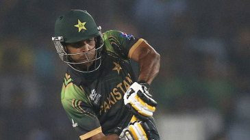 Mohammad Hafeez goes for a big hit