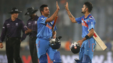 Suresh Raina and Virat Kohli celebrate India's win