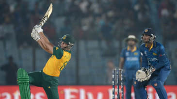 Albie Morkel swings the ball over midwicket
