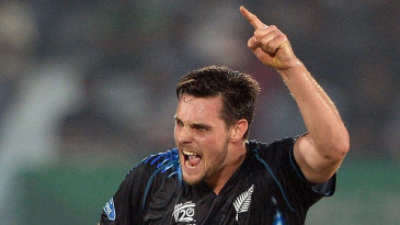 Mitchell McClenaghan is elated with the wicket of Michael Lumb