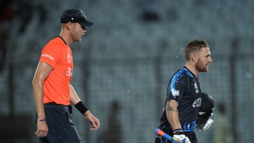 Brendon McCullum and Stuart Broad trudge off the field as it starts to pour