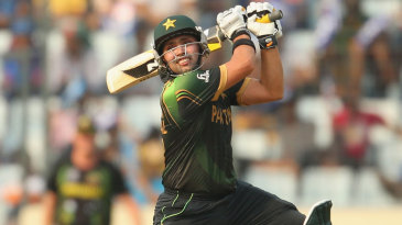 Kamran Akmal muscles the ball through the off side