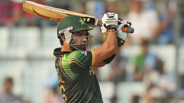 Umar Akmal plays a shot during his fifty