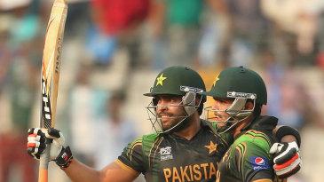 Kamran Akmal congratulates Umar Akmal on his fifty