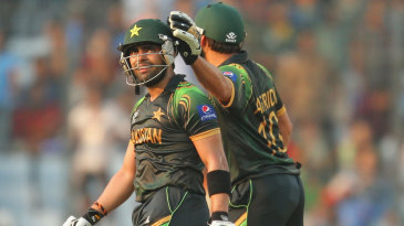 Shahid Afridi consoles Umar Akmal after the latter was out for 94