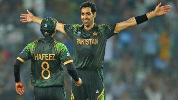 Umar Gul celebrates after dismissing Brad Hodge