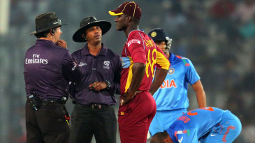 Darren Sammy talks to the umpires as the start of India's innings is delayed by a no-ball review
