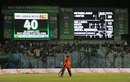 Ahsan Malik walks back as the scoreboard confirms Netherlands' plight, Netherlands v Sri Lanka, World T20, Group 1, March 24, 2014