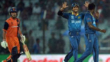 Dinesh Chandimal celebrates Peter Borren's wicket with Angelo Mathews