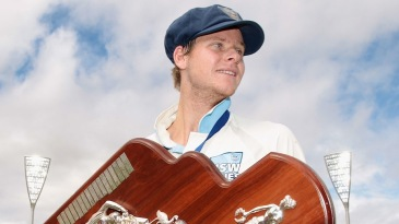 Steven Smith holds the spoils