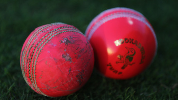 An old and new pink ball