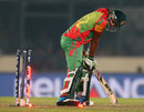 Sohag Gazi is bowled by an Andre Russel yorker, Bangladesh v West Indies, World T20, Group 2, Mirpur, March 25, 2014