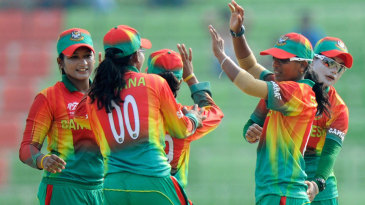 The Bangladesh team celebrate the fall of Sarah Taylor's wicket