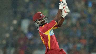 Darren Sammy lofts the ball down the ground