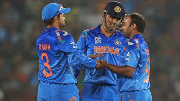 MS Dhoni congratulates Amit Mishra after the bowler dismissed Anamul Haque