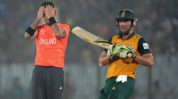 Jade Dernbach reacts after being hit for a boundary