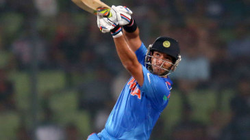 Yuvraj Singh launches the ball over the top