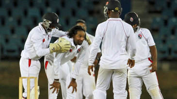 Team-mates congratulate Imran Khan after he took a wicket
