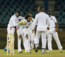 Team-mates congratulate Imran Khan after he took a wicket, Trinidad & Tobago v Combined Campuses and Colleges, Regional Four Day Competition, Port of Spain, March 30, 2014