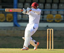 Shacaya Thomas plays a pull shot during his hundred, Trinidad & Tobago v Combined Campuses and Colleges, Regional Four Day Competition, Port of Spain, March 30, 2014