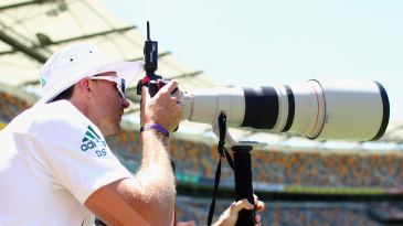 Dale Steyn looks through a photographer's camera