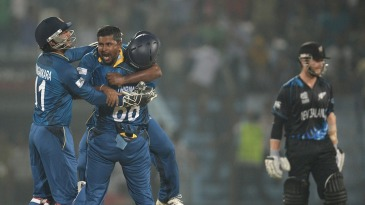 Rangana Herath celebrates Jimmy Neesham's wicket