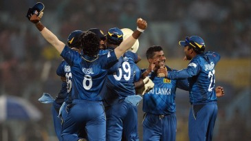 The Sri Lankans gather to celebrate a stunning win