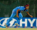 India's Shubhlakshmi Sharma after delivering the ball, India v Pakistan, Women's World T20, WT20 2016 Qualification Playoff, Sylhet, April 2, 2014