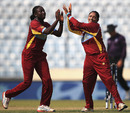 Stafanie Taylor and Anisa Mohammed celebrate the fall of Elyse Villani, Australia v West Indies, Women's World T20, 1st semi-final, Mirpur, April 3, 2014