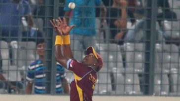 Dwayne Bravo prevents a six