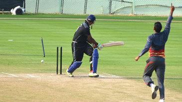 Karnataka's K Gowtham was bowled by Sayed Badiuzzama