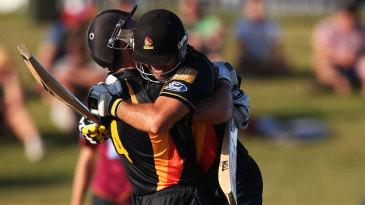 Luke Ronchi and Luke Woodcock celebrate the winning runs