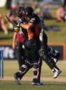 Luke Ronchi and Luke Woodcock celebrate the winning runs, Northern Districts v Wellington, The Ford Trophy final, Mount Maunganui, April 5, 2014