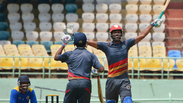 Goa's Amit Yadav celebrates after hitting a six of the last ball to seal a thriller