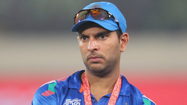 A dejected Yuvraj Singh looks on