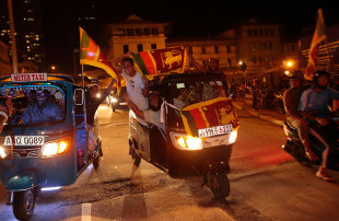 Cricket fans in Colombo are overjoyed after Sri Lanka beat India in the final of the World T20, Colombo, April 6, 2014