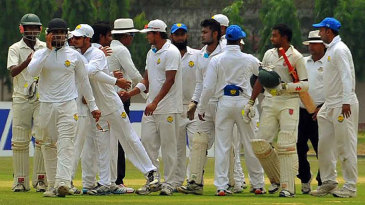 Players shake hands after Rangpur Division's 314-run win