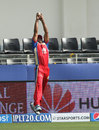 Sachin Rana times his leap to perfection to take the catch of Kieron Pollard, Royal Challengers Bangalore v Mumbai Indians, Indian Premier League, Dubai, April 19, 2014