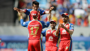 Yuzvendra Chahal is congratulated after a wicket