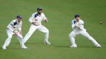Andy Hodd takes a catch as the slip cordon looks on