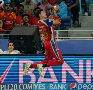 Mitchell Starc takes the first of two amazing catches, Kings XI Punjab v Royal Challengers Bangalore, IPL 2014, Dubai, April 28, 2014