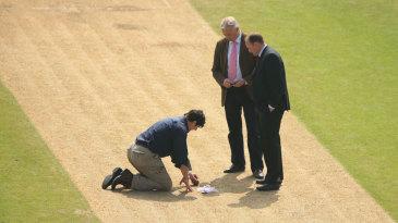 Tony Pigott and David Capel inspect the pitch