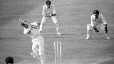 Geoff Boycott drives through mid-on to reach his 100th hundred