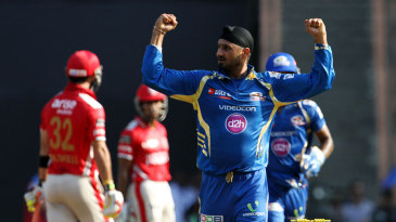 Harbhajan Singh celebrates the wicket of Glenn Maxwell
