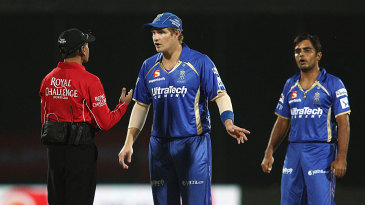 Shane Watson has a chat with umpire Sanjay Hazare over a run-out appeal that wasn't referred