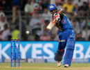 CM Gautam thumps the ball through the off side, Mumbai Indians v Royal Challengers Bangalore, IPL 2014, Mumbai, May 6, 2014