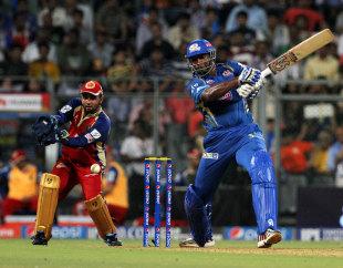 Kieron Pollard muscles the ball through the covers, Mumbai Indians v Royal Challengers Bangalore, IPL 2014, Mumbai, May 6, 2014