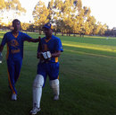 Suresh Perera walks back after scoring a century for the Sri Lankan Lions in Perth